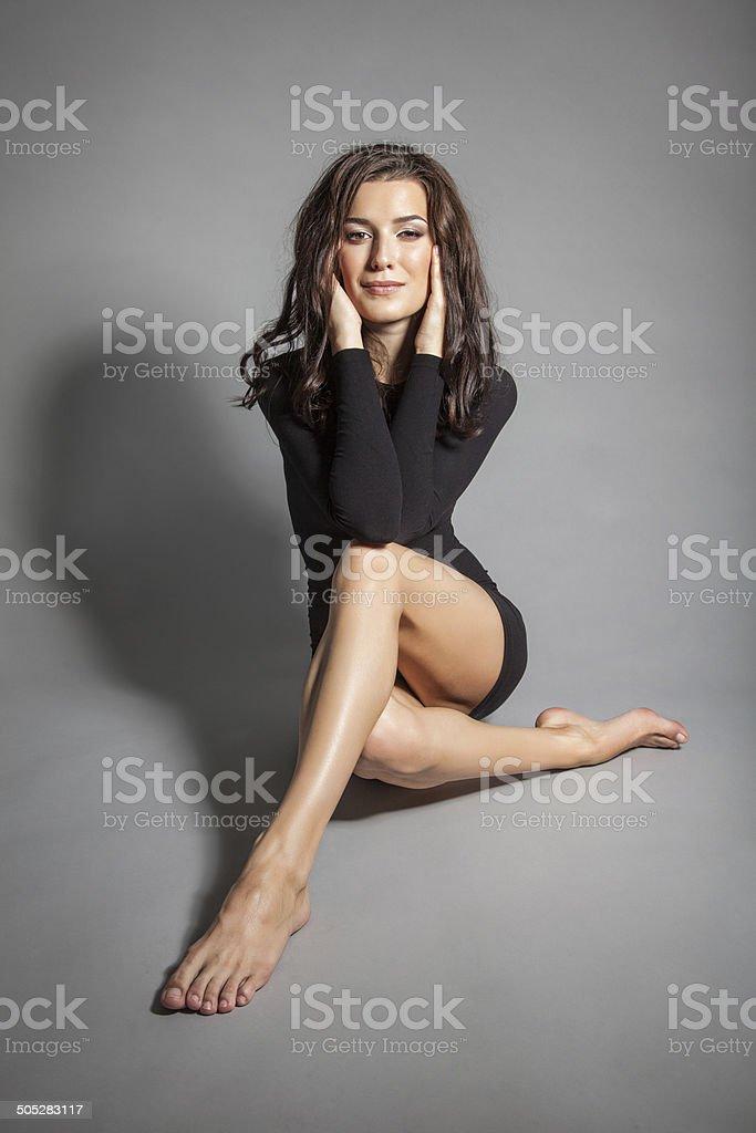Portrait of brunette beautiful girl posing in black dress stock photo