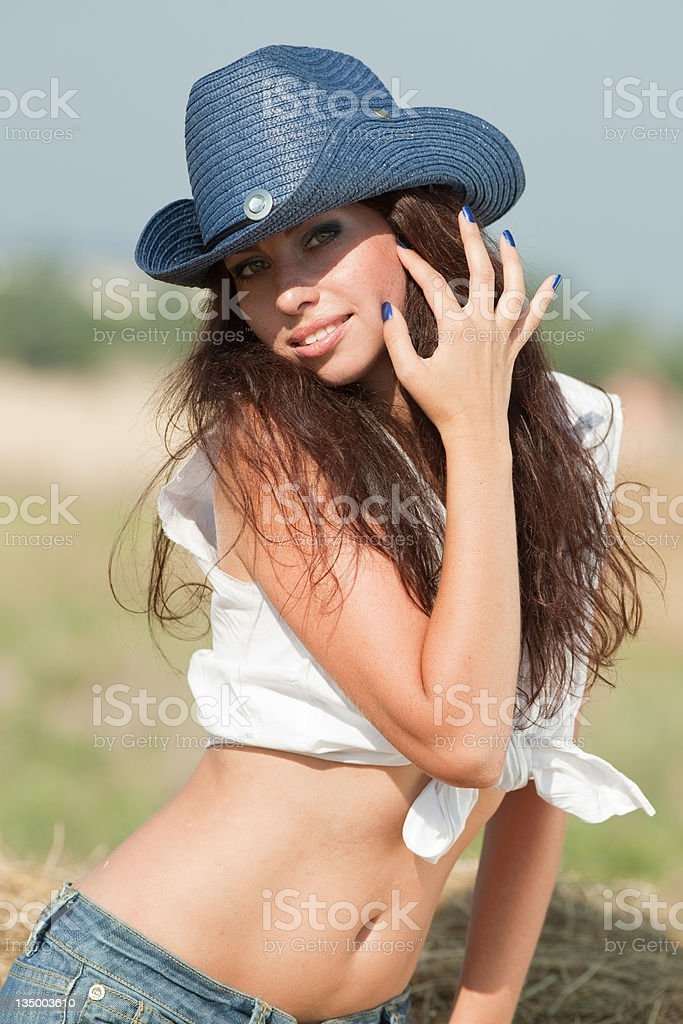 Portrait of brunette in hat at the field stock photo
