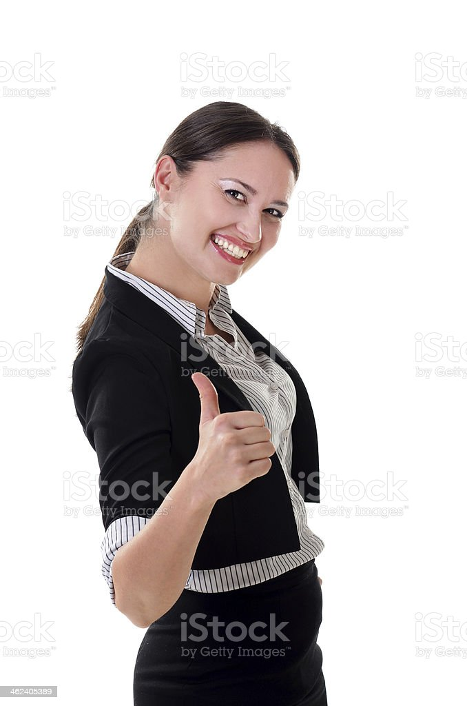 Portrait of brunette tall businesswoman in skirt showing thumb up stock photo