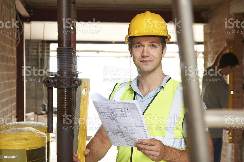 Portrait Of Builder On Site With Plans royalty-free stock photo