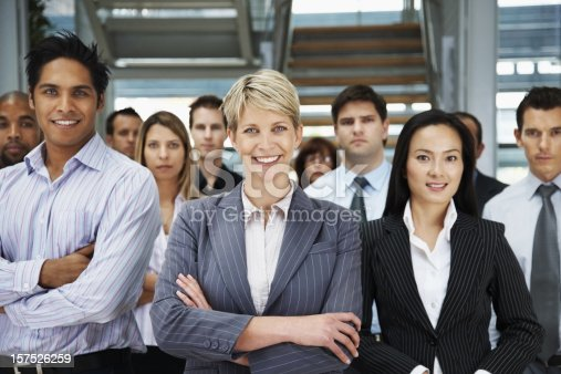 istock Portrait of business colleagues smiling in office 157526259