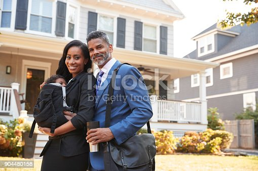 istock Portrait Of Business Couple With Baby Son Leaving House For Work 904480158