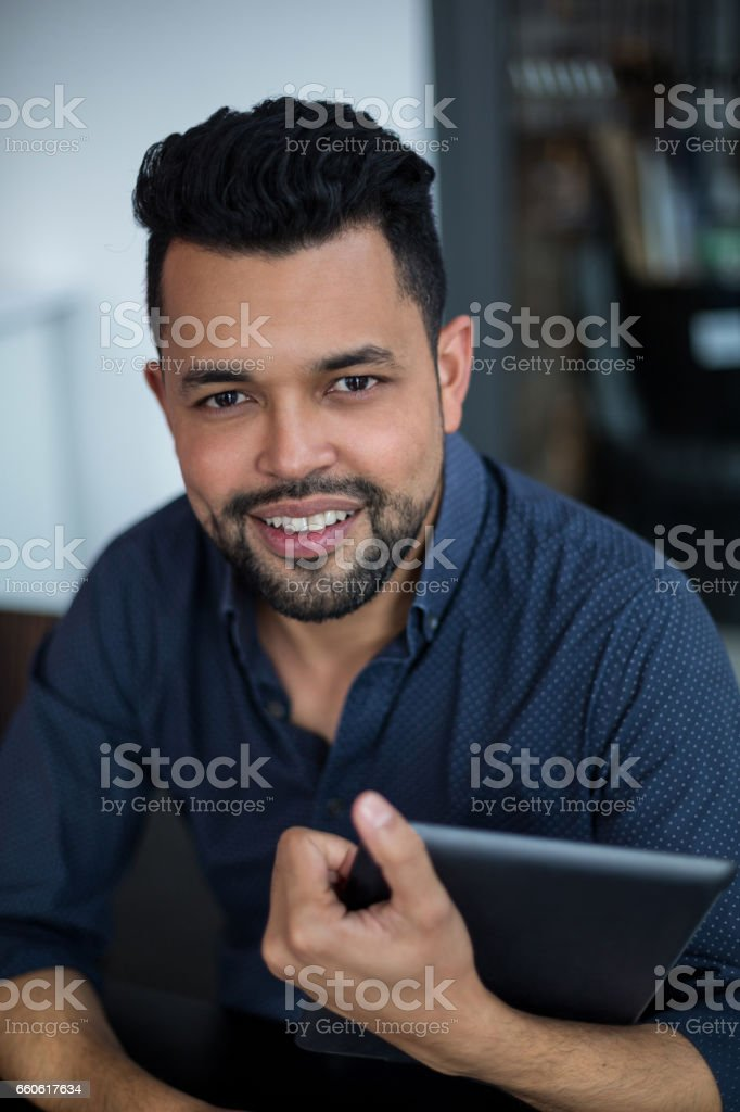 Portrait of business executive using digital tablet in office royalty-free stock photo