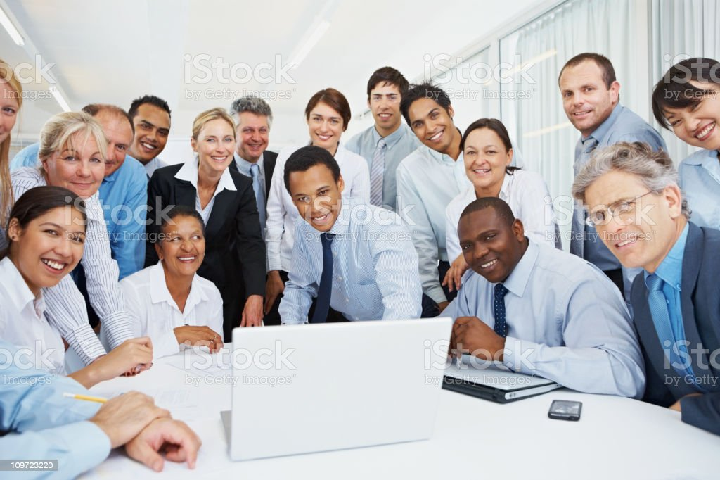 Portrait of business executives with laptop in a meeting royalty-free stock photo