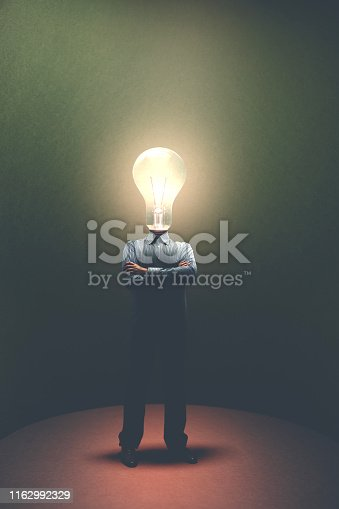 861553788 istock photo portrait of business man with light bulb on his head, surreal concept 1162992329