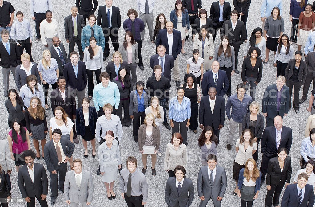Portrait of business people in crowd stock photo
