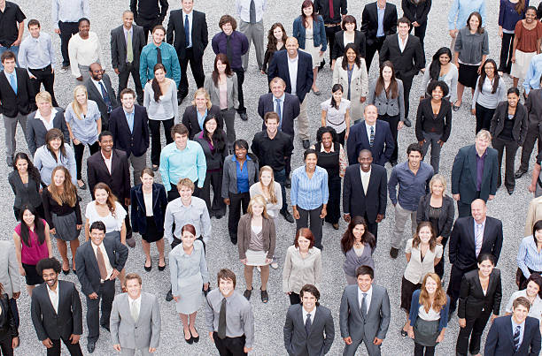 portrait of business people in crowd - crowded stock pictures, royalty-free photos & images