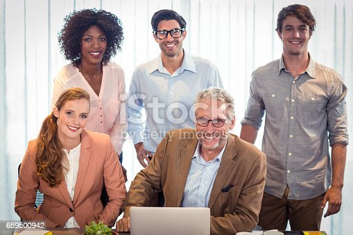istock Portrait of business people smiling 659500942