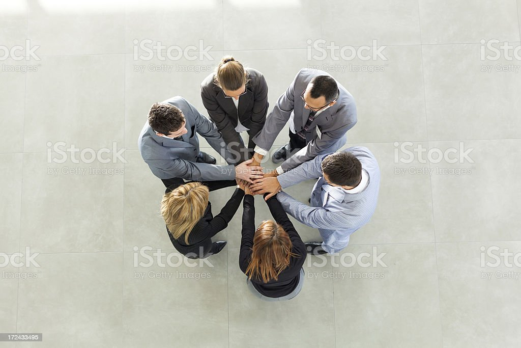 Portrait of business people with hands on top royalty-free stock photo