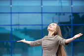Portrait of business woman feeling happy with open arms