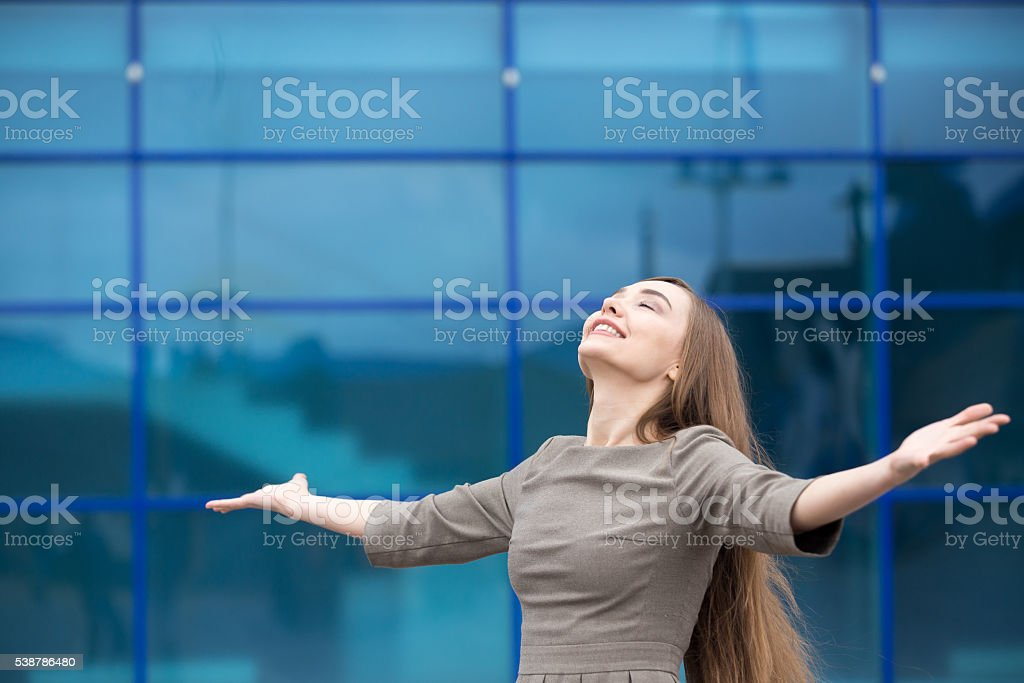 Portrait of business woman feeling happy with open arms stock photo