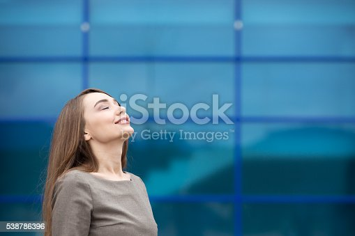 istock Portrait of business woman relaxing and feeling happy. Copy spac 538786396