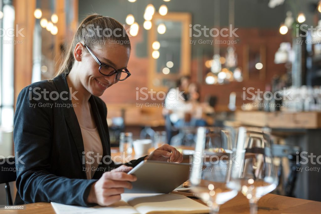 Portrait of business woman  sitting at restaurant table stock photo
