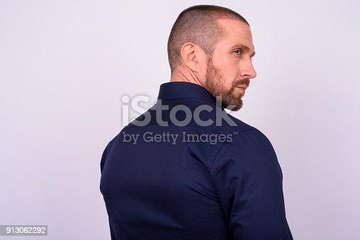 istock Portrait Of Businessman Against White Background 913062292