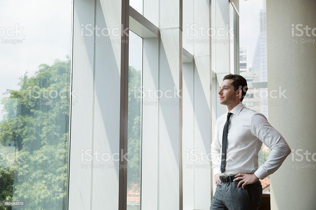 Portrait of Businessman at Window 4 – Foto