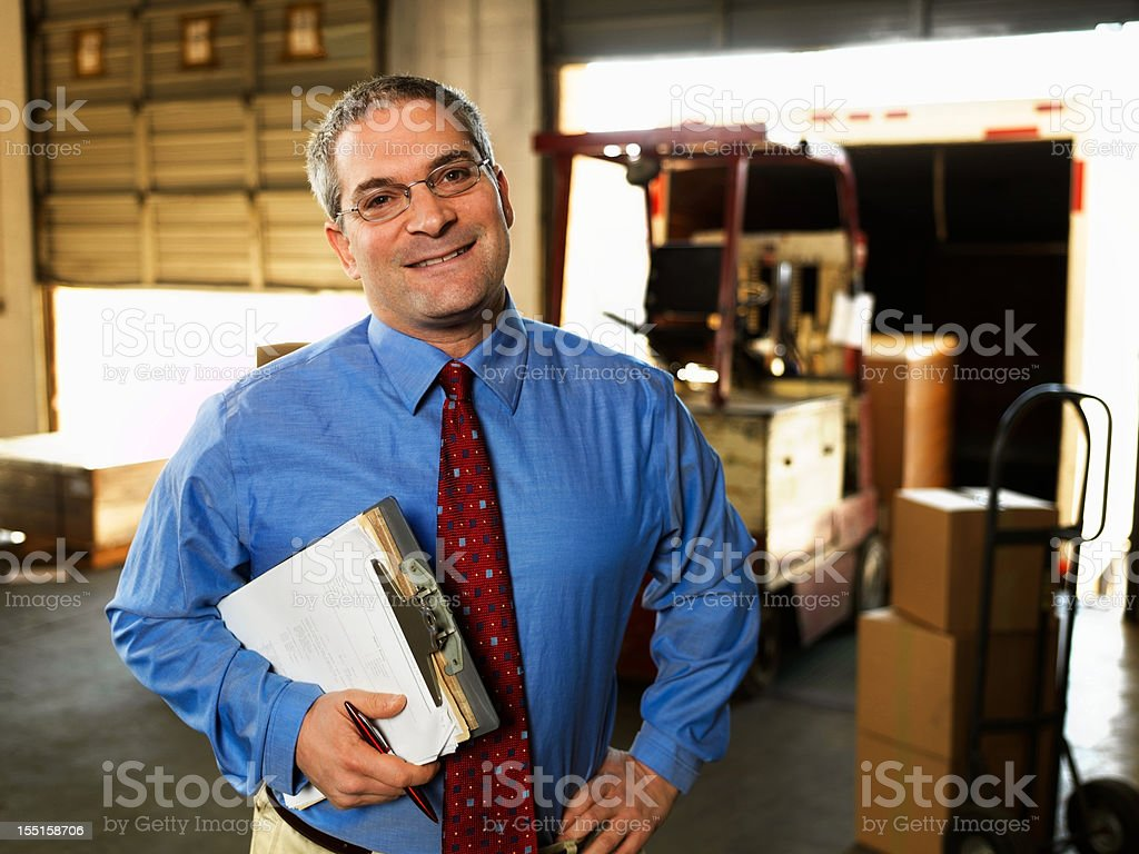 Portrait of Businessman in a Warehouse royalty-free stock photo