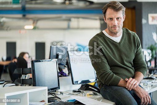 istock Portrait of businessman in creative office 628498818