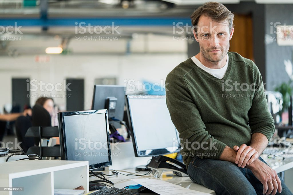 Portrait of businessman in creative office stock photo