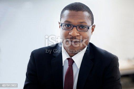 istock Portrait of businessman in office 637912602