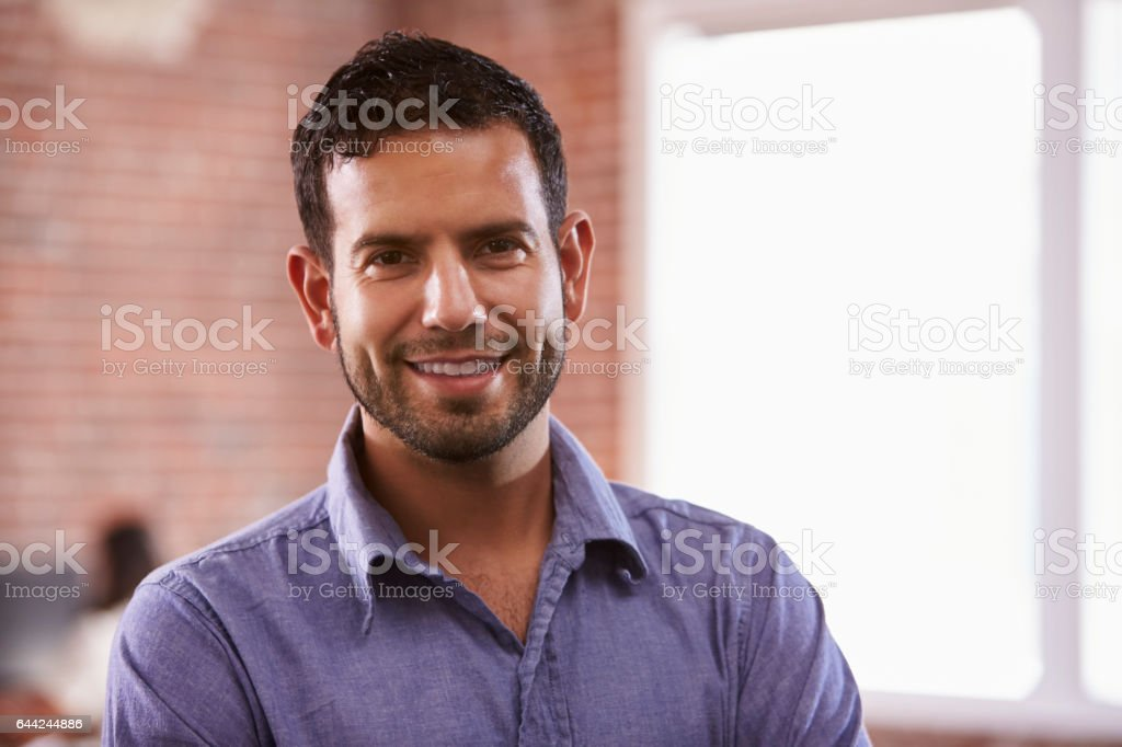 Portrait Of Businessman In Office Standing By Window stock photo