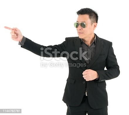 951331990 istock photo Portrait of businessman in suit is happy and present and point to something, isolated on white background 1144762761