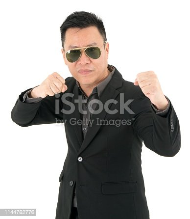 951331990 istock photo Portrait of businessman in suit is ready to fight showing concept of business on going, isolated on white background 1144762776