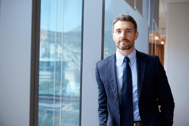Portrait of businessman standing by window in office picture id677893576?b=1&k=6&m=677893576&s=612x612&w=0&h=9hqj8zi4nmivgpjfqrlvbgdgq hxxeb8ev6m6kyoyqe=