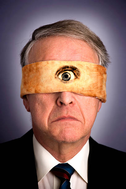 Portrait of Businessman Wearing Blindfold with One Eye  critic stock pictures, royalty-free photos & images