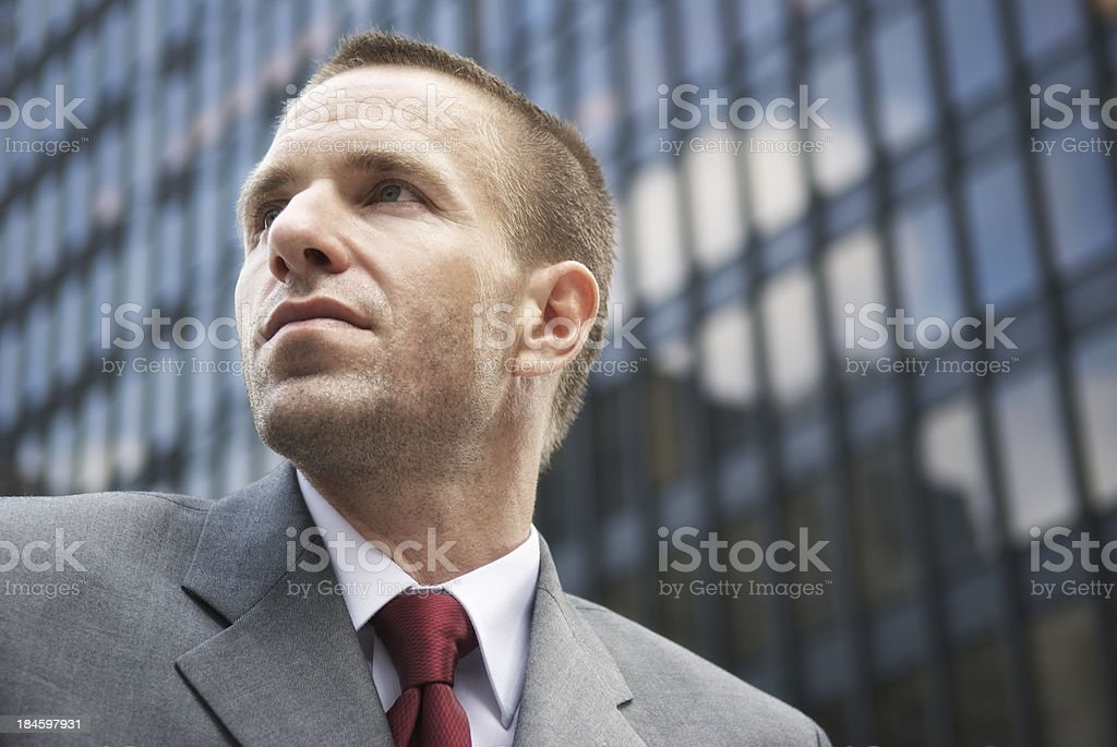 Portrait of Businessman with Cropped Hair at Office Tower stock photo