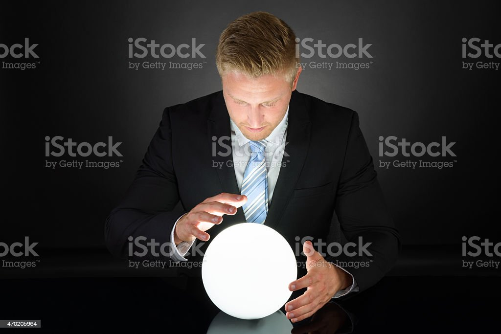 Portrait Of Businessman With Crystal Ball stock photo