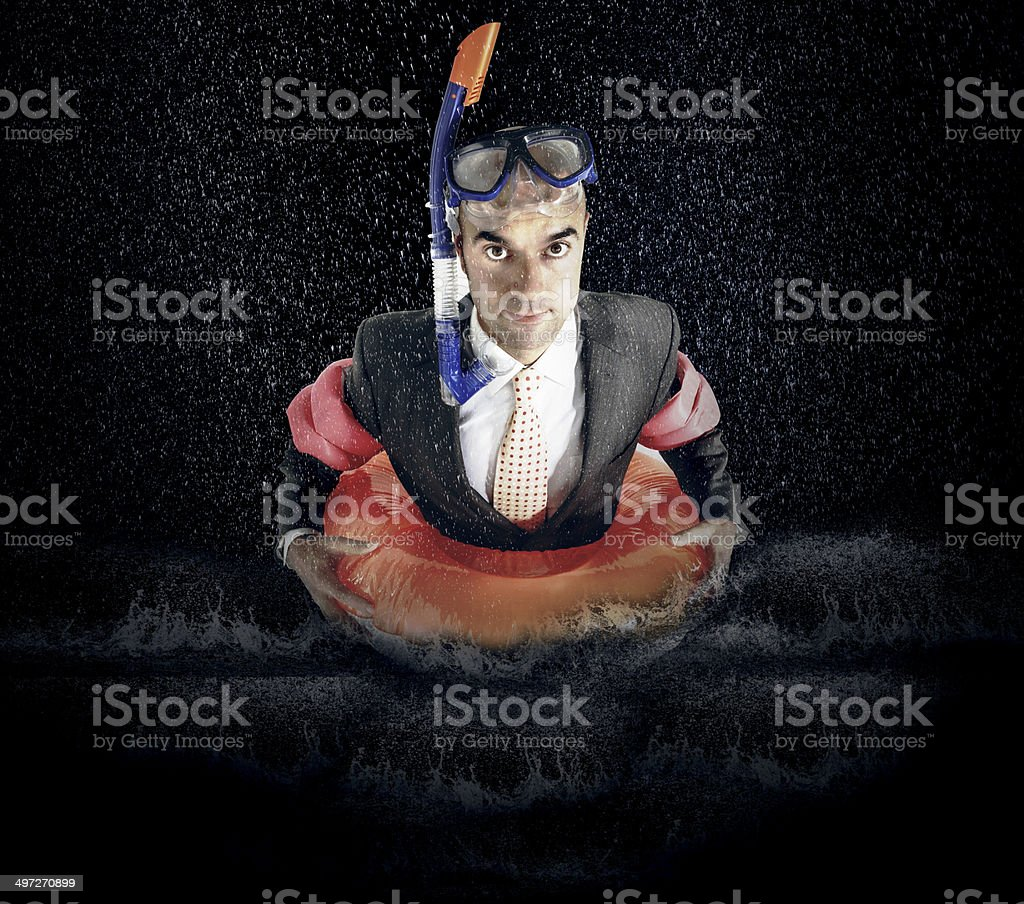 Portrait of businessman with diving equipment in water stock photo