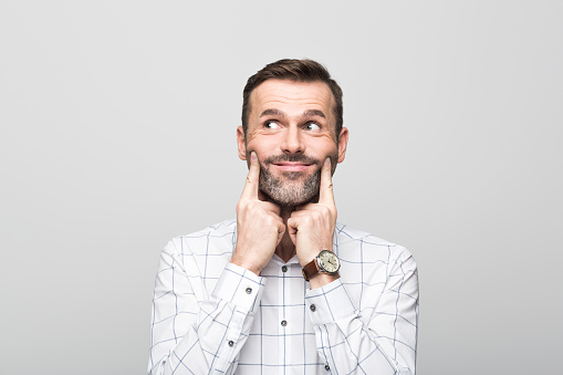 Portrait Of Businessman With Fake Smile Grey Background Stock Photo - Download Image Now
