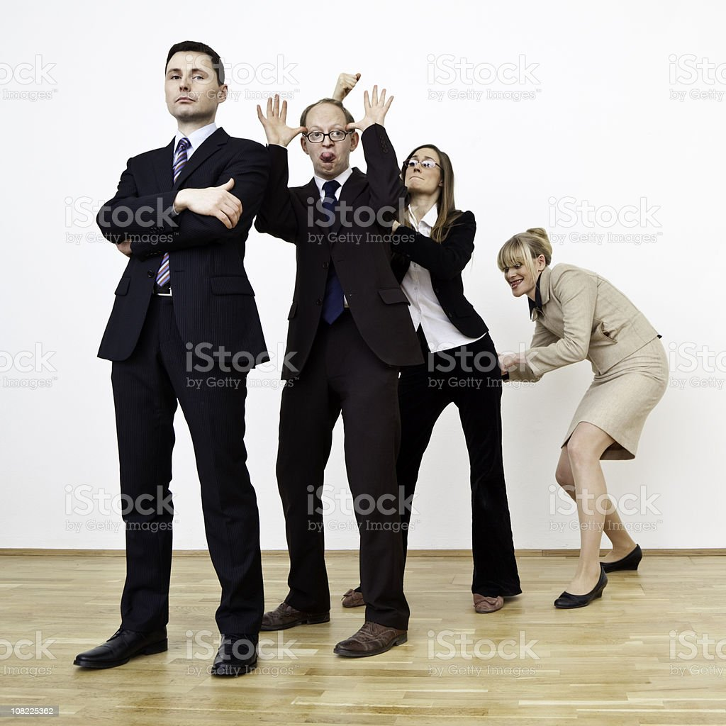 Portrait of Businessman with His Team Being Silly royalty-free stock photo
