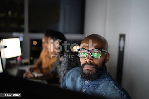 istock Portrait of businessman working late in the office 1146025965