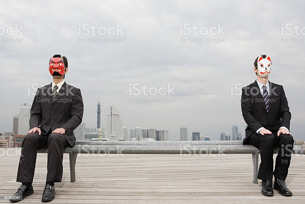 Portrait of businessmen wearing masks royalty-free stock photo