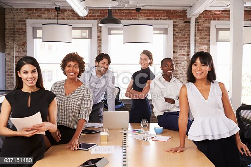 502281620 istock photo Portrait Of Businesspeople Meeting Around Table In Office 637151480