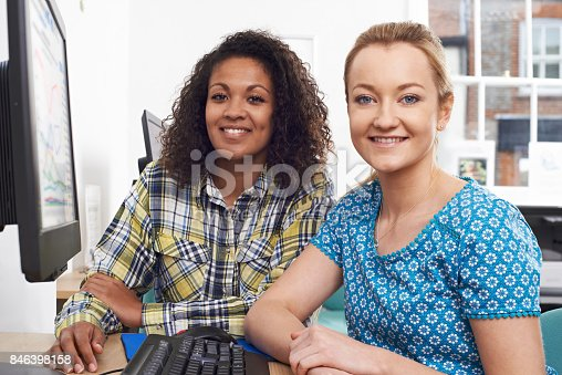 istock Portrait Of Businesswoman Giving Computer Training In Office 846398158