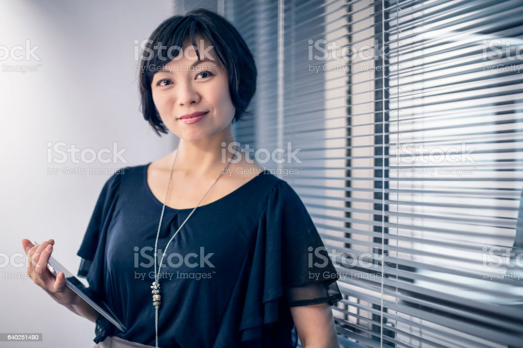 Portrait of businesswoman holding digital tablet stock photo