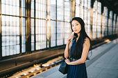Portrait of businesswoman in train station.