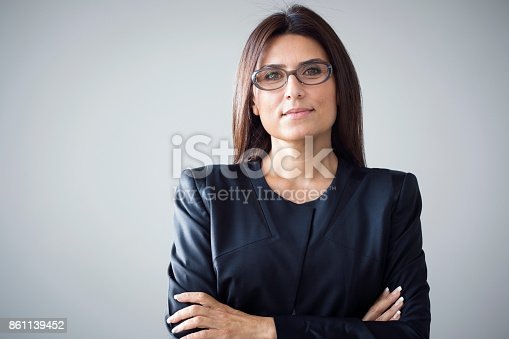 istock Portrait of businesswoman on grey background 861139452