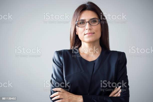 Portrait of businesswoman on grey background picture id861139452?b=1&k=6&m=861139452&s=612x612&h=o6r09ahoao2whkx65dmcbwquxarkc mcwluz7y20amo=