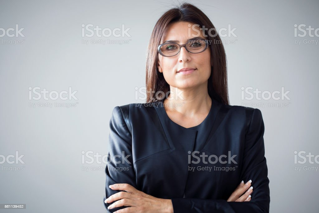 Portrait of businesswoman on grey background stock photo