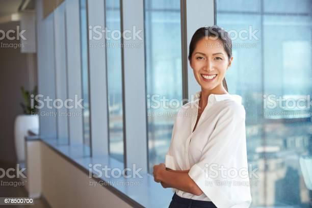 Portrait of businesswoman standing by window in office picture id678500700?b=1&k=6&m=678500700&s=612x612&h=ojdknjxidqsj9cgye9 3al0zz1krej  py6i czxaa0=