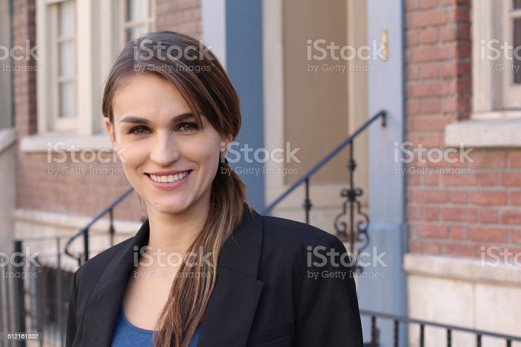 Portrait Of Businesswoman Standing In Street stock photo