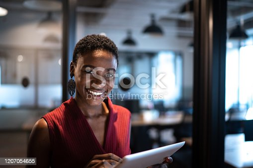 Portrait of businesswoman using digital tablet at office