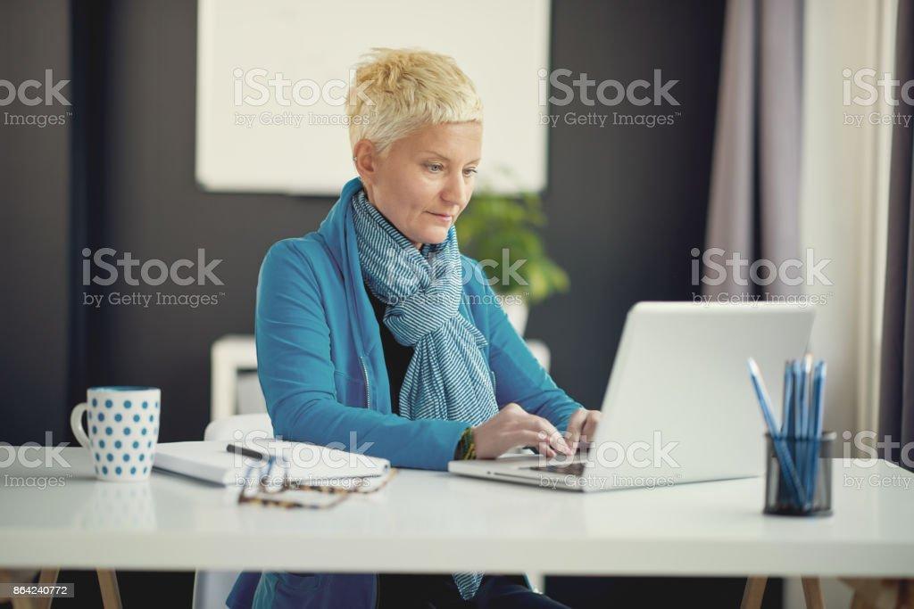 Portrait of businesswoman using laptop royalty-free stock photo