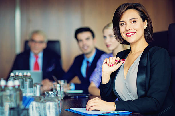 Portrait of businesswoman with her team - Photo