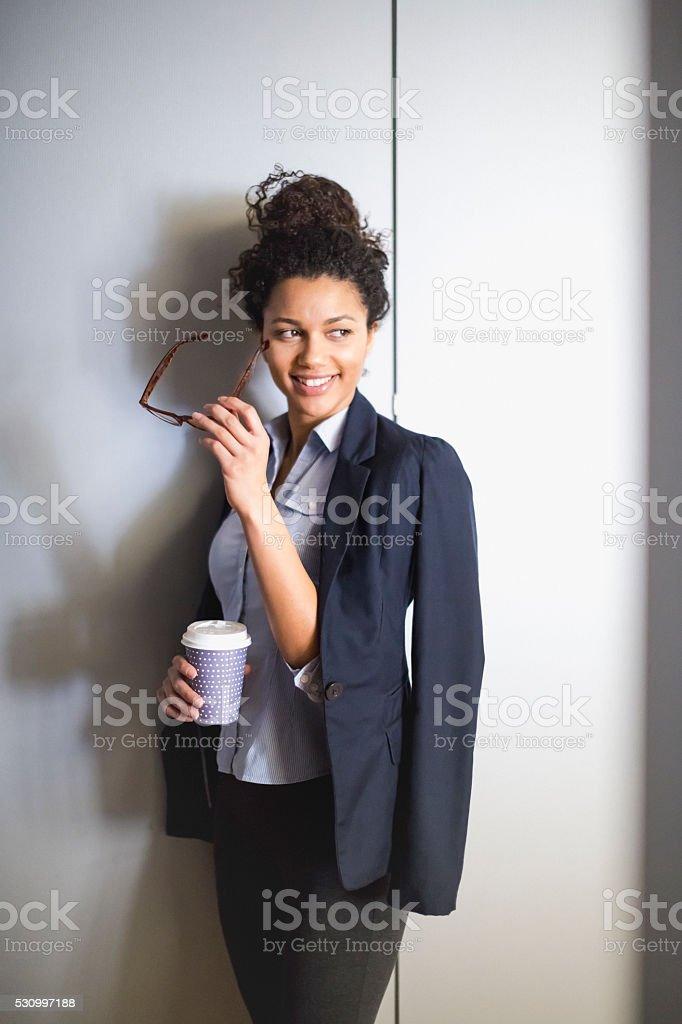 Portrait of businesswoman with mug stock photo
