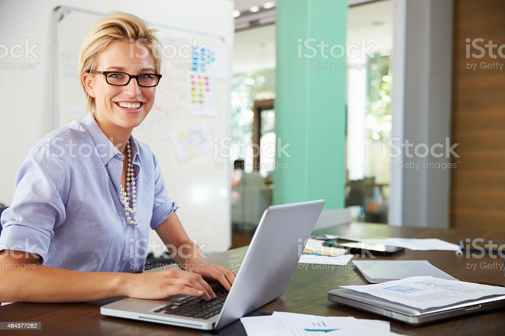 Portrait Of Businesswoman Working In Creative Office royalty-free stock photo