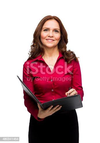 1150572074istockphoto Portrait of businesswoman writing on file 480341454